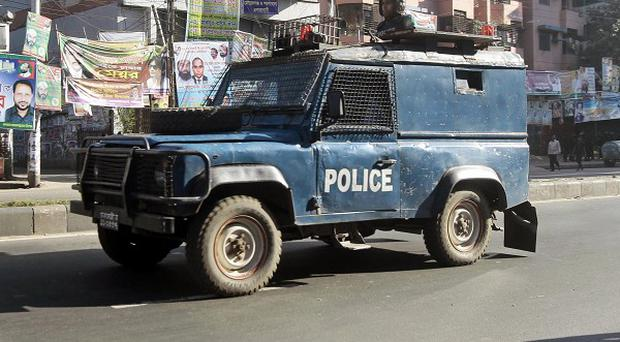 A Bangladeshi security vehicle amid a four-day general strike in Dhaka (AP)
