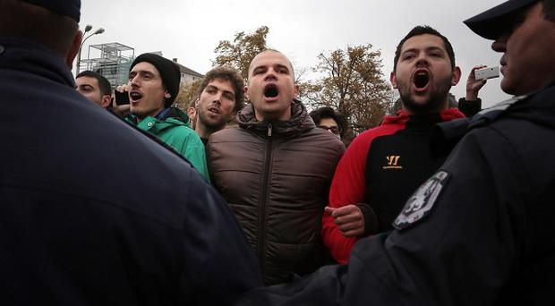 Students shout anti-government slogans during a protest in Sofia, Bulgaria (AP)