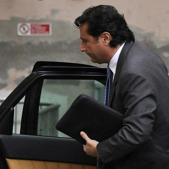 Francesco Schettino arrives at court in Grosseto, central Italy (AP)