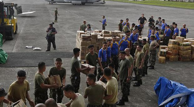 Aid is trickling into the typhoon-shattered city of Tacloban