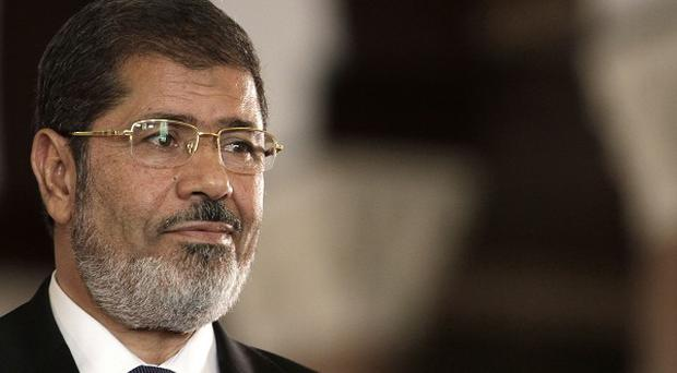 Deposed Egyptian president Mohammed Morsi has accused his captors of treason (AP)