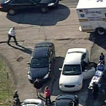 Emergency personnel respond to a shooting near Brashear High School in Pittsburgh (AP/KDKA-TV)