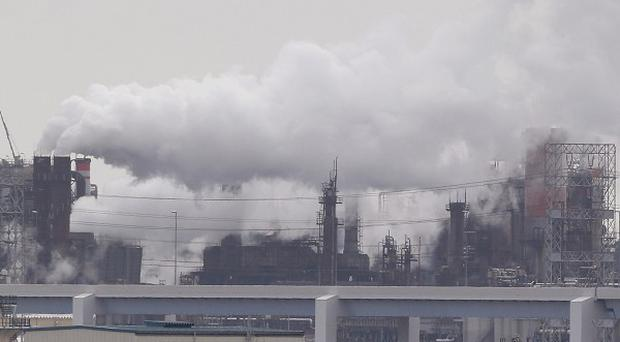 Smoke billows from an oil refinery in Kawasaki, southwest of Tokyo. (AP)