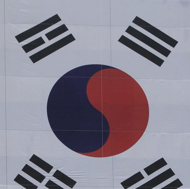 Two people have died after a helicopter clipped a building in South Korea