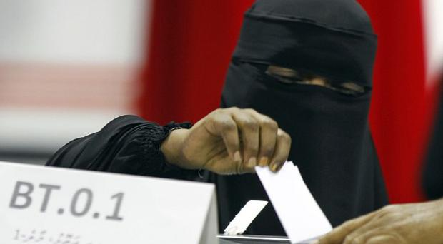 A veil-clad Maldivian woman casts her vote in Male (AP)