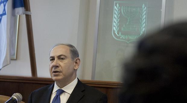Israeli prime minister Benjamin Netanyahu is to host French president Francois Hollande in a three-day visit (AP)