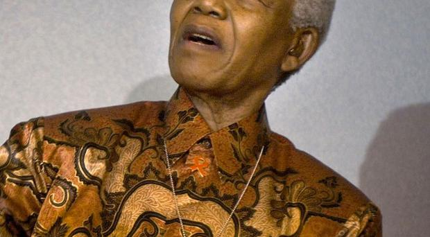 Nelson Mandela is still 'quite ill', his former wife has said