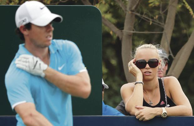Caroline Wozniacki watches Rory McIlroy in Dubai