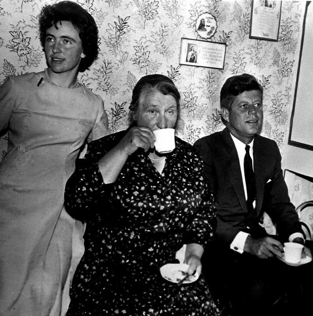 US President John F Kennedy having tea with his second cousin Mary Ryan (centre) and her daughter Josephine Ryan during a visit to the farm at New Ross in 1963