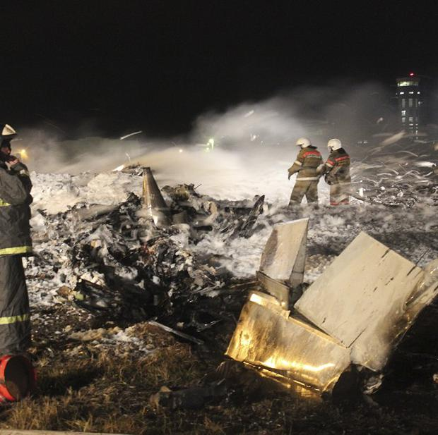 Firefighters and rescuers work at the crash site of a Russian passenger airliner near Kazan, about 450 miles east of Moscow (AP/Russian Emergency Situations Ministry)
