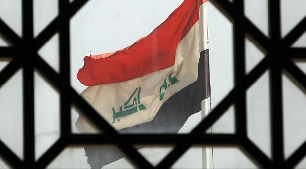 An official said Iraq has hanged 12 prisoners who had been convicted of terrorism-related charges.