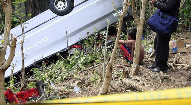A tour bus plunged into a ravine on Bali, killing seven people including five Chinese tourists, police said (AP)