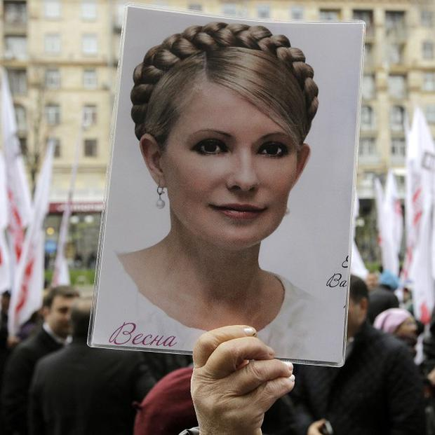 A supporter of former Ukrainian Prime Minister Yulia Tymoshenko holds up her picture during a protest rally (AP)