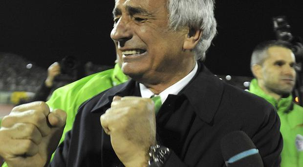 Algeria's coach Vahid Halilhodzic celebrates the victory against Burkina Faso that sent his side to the World Cup (AP)