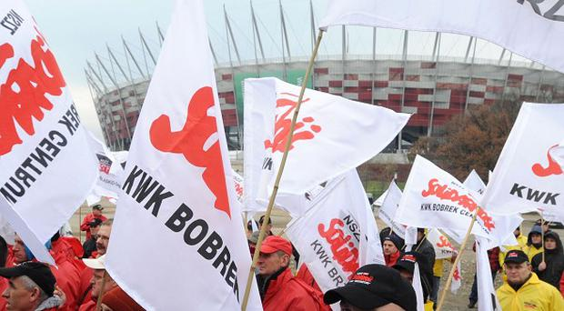 Polish trade unionists supporting the coal mining industry outside the talks (AP)