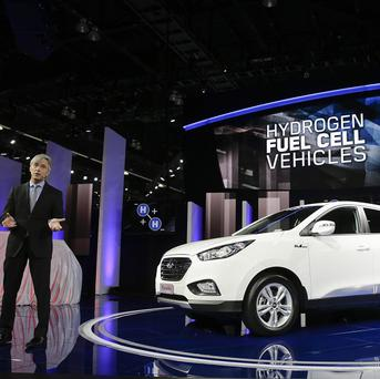 John Krafcik, president and CEO of Hyundai Motor America, introduces the Tucson Fuel Cell hydrogen-powered electric vehicle at the Los Angeles Auto Show (AP/Jae C Hong)