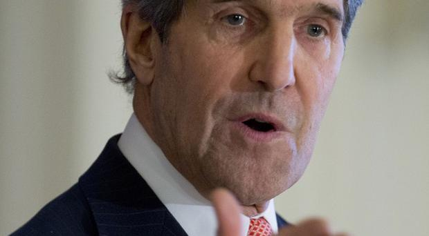 Secretary of state John Kerry says the US and Afghanistan have reached agreement on a bilateral security pact. (AP/Carolyn Kaster)