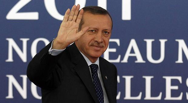 Turkish prime minister Recep Tayyip Erdogan was not in his office when a suspected bomber was arrested nearby.