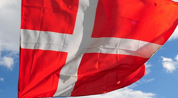The Danish foreign aid minister has admitted lying to parliament