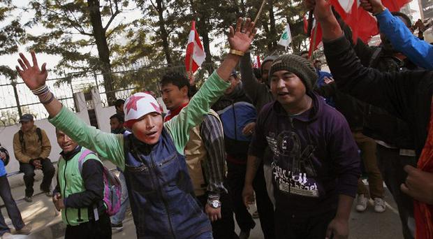 Supporters of the Nepali Congress party outside a vote counting centre in Katmandu (AP)