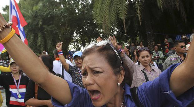 An anti-government protester in front of the Constitutional Court in Bangkok (AP)