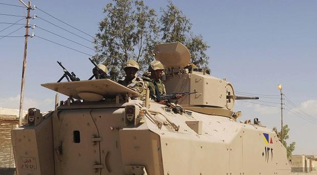 The northern Sinai region, which borders the Gaza Strip and Israel, has been restless for years (AP)