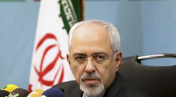 Mohammad Javad Zarif, Iran's foreign minister, has defended his country's nuclear deal against critics at home (AP)