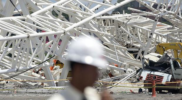 The collapse at the Itaquerao stadium in Sao Paolo resulted in the death of at least two workers (AP)