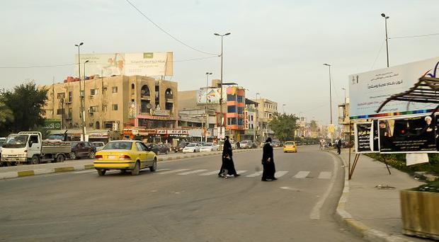The bodies of 18 abducted men have been found in a town near Baghdad.