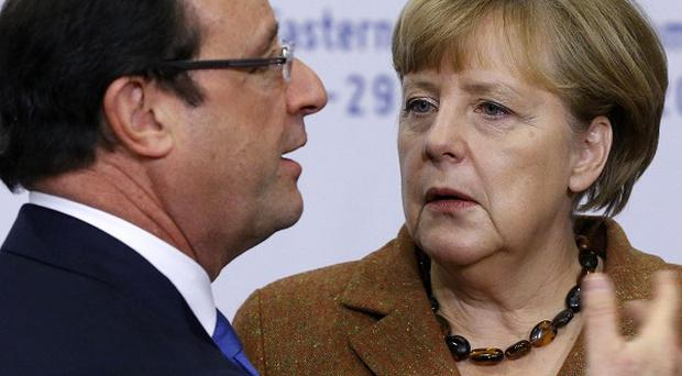 French President Francois Hollande and German Chancellor Angela Merkel failed to persuade Ukraine to sign up to the deal (AP)