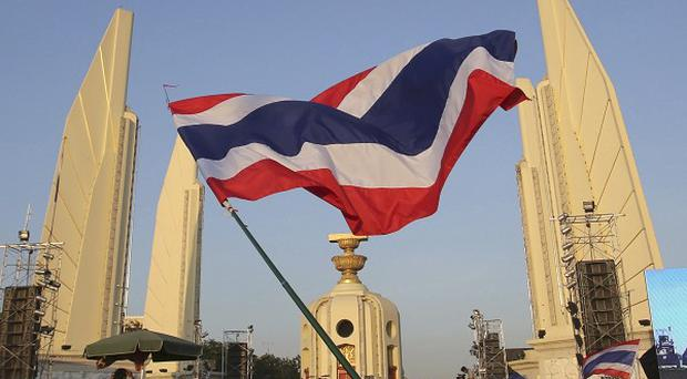 Anti-government protesters gather in front of the Democracy Monument during a rally in Bangkok.