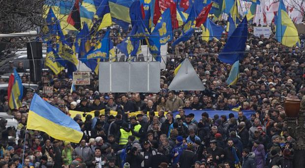 Thousands of Ukrainians march to Independence square in downtown Kiev (AP)
