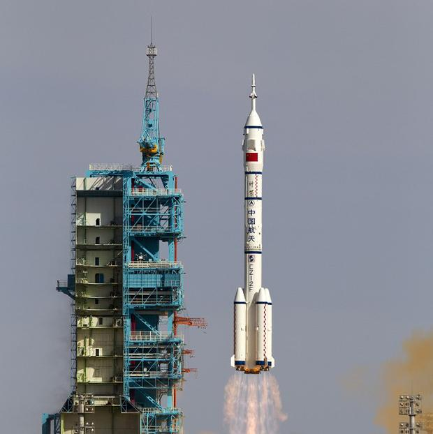 To the moon: The Long March 2F rocket carrying the Shenzhou 10 manned spacecraft lifts off in June. Now a Long March-£B rocket has blasted off on a mission to land a rover on the moon