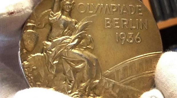 One of four Jesse Owens 1936 Olympics gold medals is up for auction. (AP/Raquel Dillon)