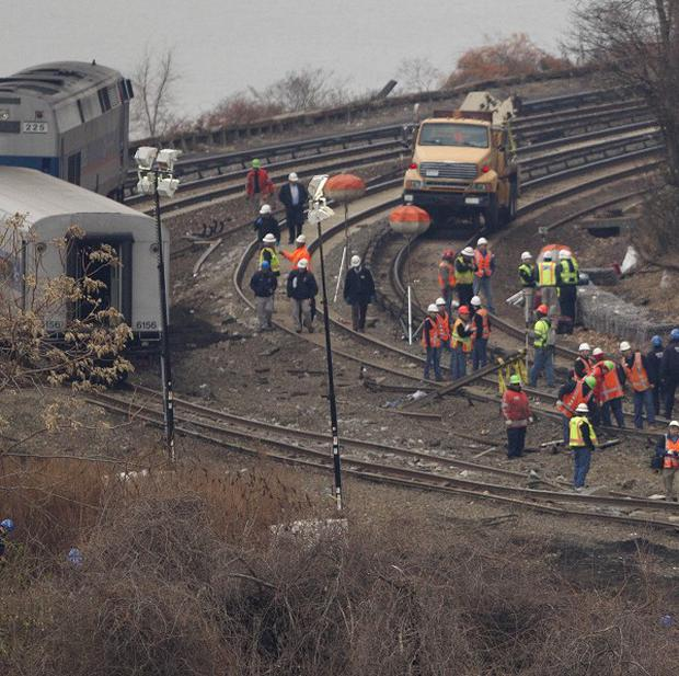 The aftermath of the derailment in the Bronx borough of New York which killed 4 four people and injured about 60. (AP/Mark Lennihan)