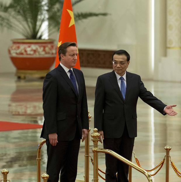 David Cameron has secured a pig semen deal with China. Above: The PM with Chinese counterpart Li Keqiang during his trade visit. Photo: Getty Images