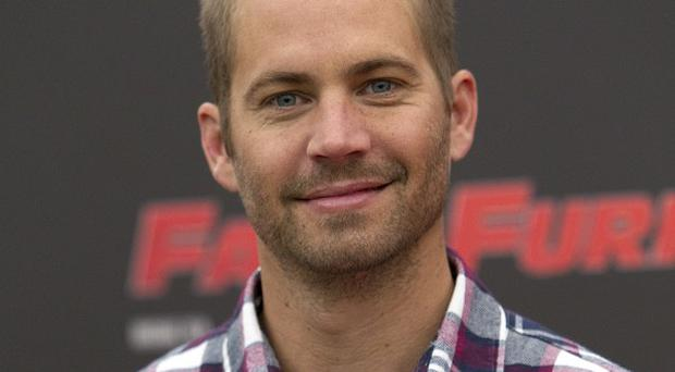 Actor Paul Walker promoting the movie Fast & Furious 5. (AP /Andrew Medichini)