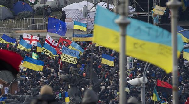 Flags wave during a rally in Kiev, Ukraine (AP)