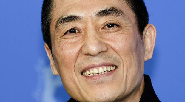 Chinese director Zhang Yimou has admitted flouting his country's strict family planning rules by having three children with his wife. (AP Photo/Markus Schreiber, File)