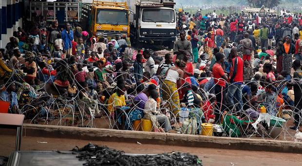 Christians gather at Bangui's airport as French military helicopters land. (AP/Jerome Delay)