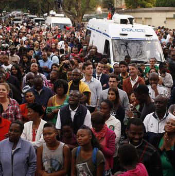 People gather for a prayer service outside the home of Nelson Mandela in Johannesburg. (AP/Themba Hadebe)