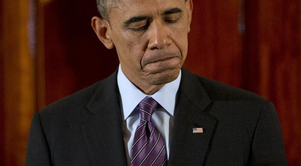President Barack Obama pauses as he speak about the death of Nelson Mandela (AP)