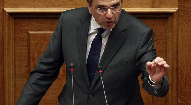 Greek prime minister Antonis Samaras delivers a speech before the 2014 budget vote. (AP)