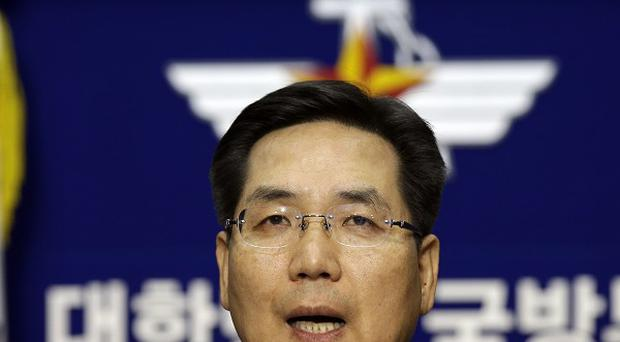 South Korean Defence Ministry spokesman Kim Min-seok speaks in Seoul on the country's new defence zone (AP)