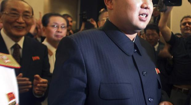 Kim Jong Un followed by his now disgraced uncle Jang Song Thaek, second from left. (AP)