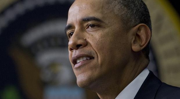 Barack Obama is under pressure to curb the US government surveillance programmes that sweep up personal information from the internet (AP)