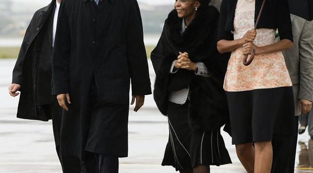 President Barack Obama and first lady Michelle Obama, right, arrive at Waterkloof Air Base in South Africa (AP)
