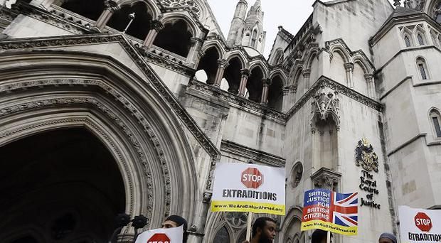 Demonstrations were held outside the Royal Courts of Justice in London last year before Babar Ahmad and Syed Talha Ahsan were extradited to the US (AP)