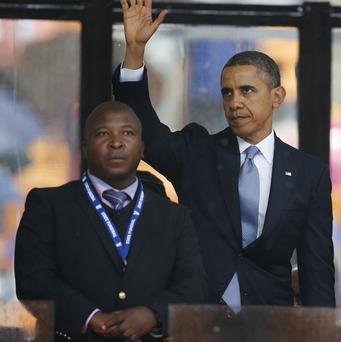President Obama next to the apparently fake sign language interpreter (AP)