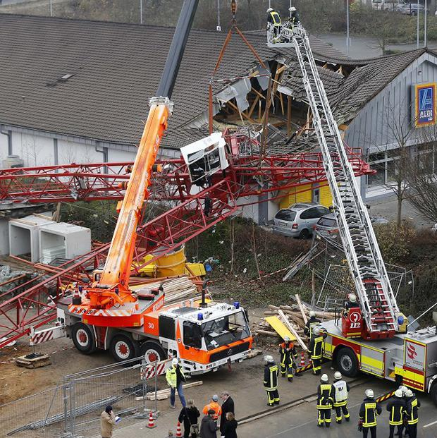 A crane has collapsed onto a German supermarket (AP)